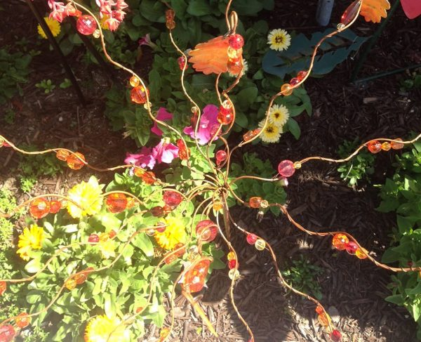 Falling Leaves and Beads yard stake will be a beautiful addition to any garden.